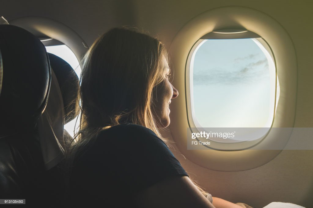 Young woman travelling with airplane : Stock Photo