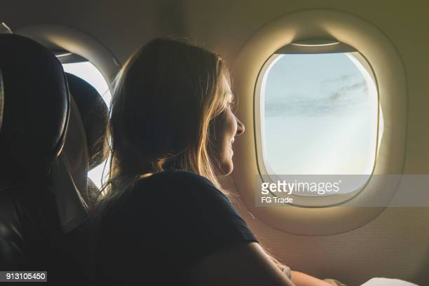 young woman travelling with airplane - volare foto e immagini stock