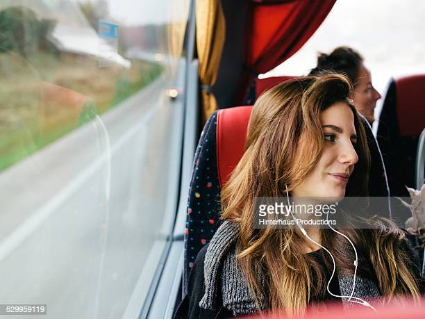 young woman travelling with bus - autocarro imagens e fotografias de stock