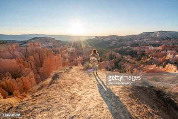 young woman travels bryce canyon national park in utah, united states, people travel explore nature. girl hiking in red rock formations - bryce canyon stock pictures, royalty-free photos & images