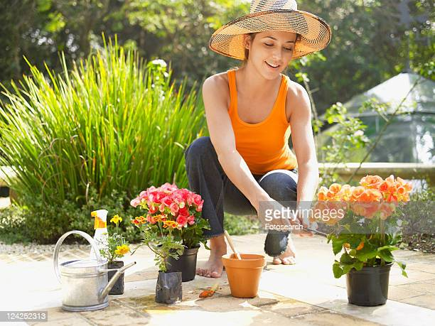 Young woman trimming flowers