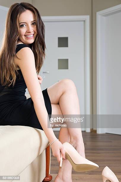 young woman trying on shoes - nylon feet stock photos and pictures