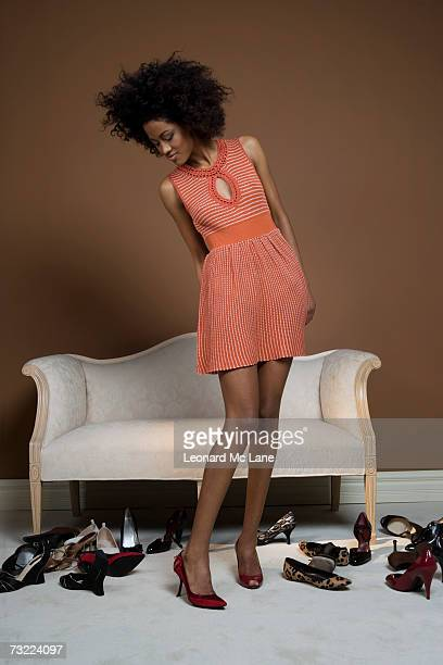 young woman trying on shoes - black shoe stock pictures, royalty-free photos & images