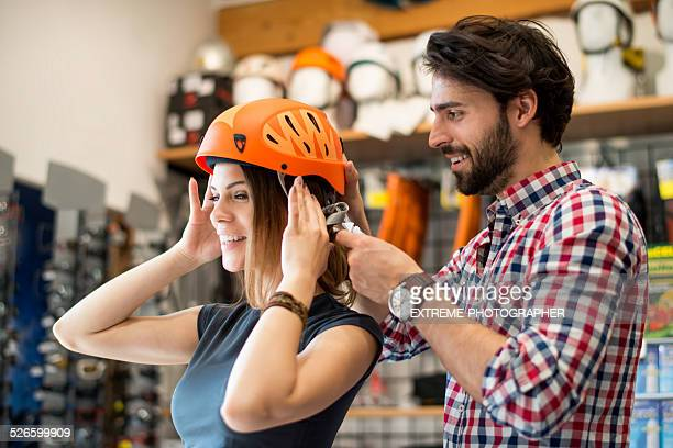 Young woman trying out sports helmet