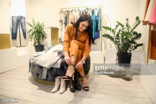 young woman trying shoes on - footwear stock pictures, royalty-free photos & images