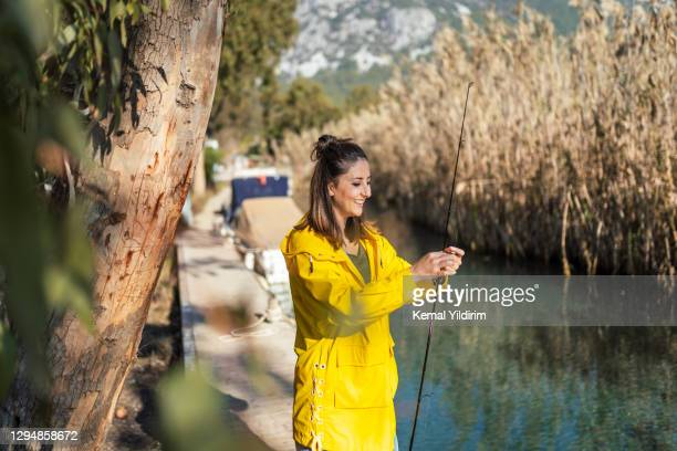 young woman trying to catch a fish - sailor suit stock pictures, royalty-free photos & images
