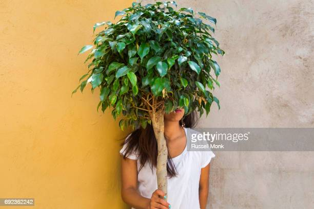 A young woman trying to hide