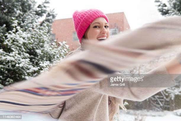young woman twirling with shawl in snow - ストール ストックフォトと画像