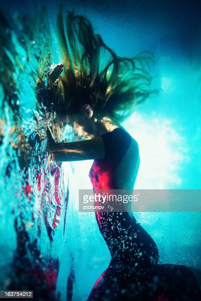 young woman underwater - mermaid stock photos and pictures