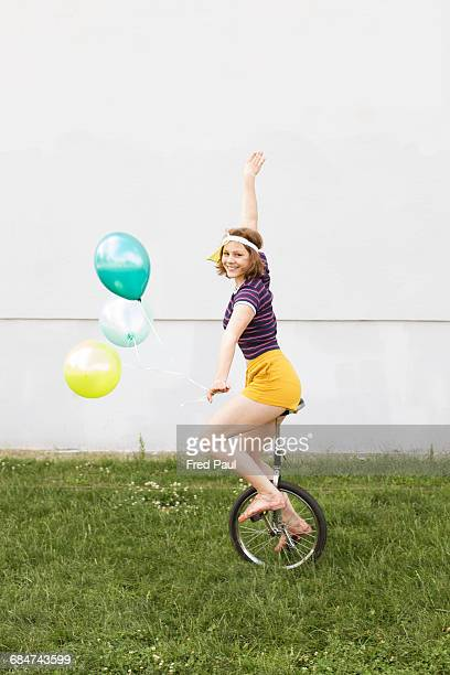 young woman unicycling