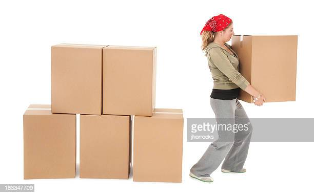 Young Woman Unstacking Cardboard Moving Boxes
