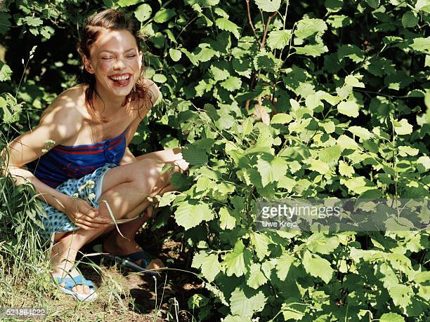 young woman urinating in the woods - urinating stock pictures, royalty-free photos & images
