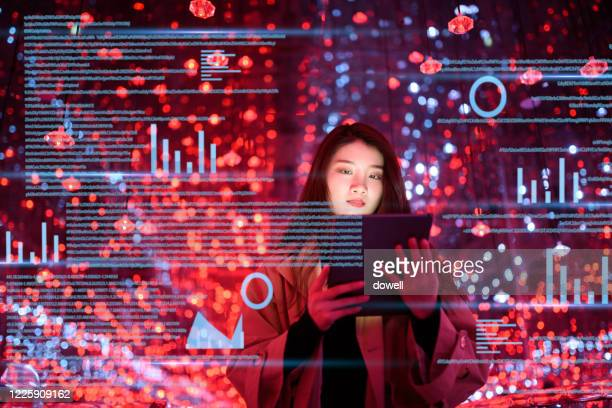 young woman uses digital tablet on virtual visual screen at night - data stock pictures, royalty-free photos & images