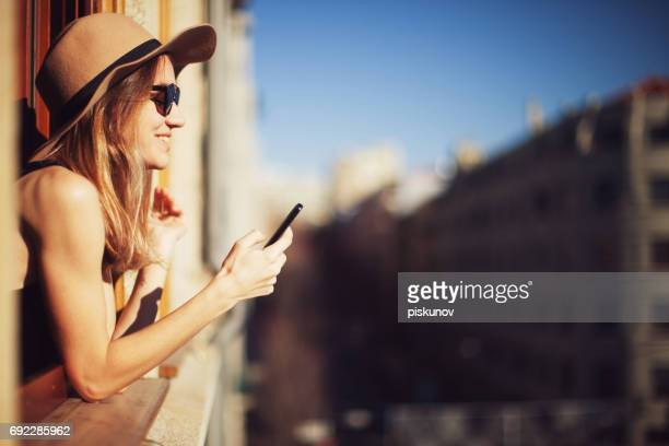 Young woman uses smartphone