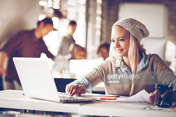 Young woman usign laptop in office