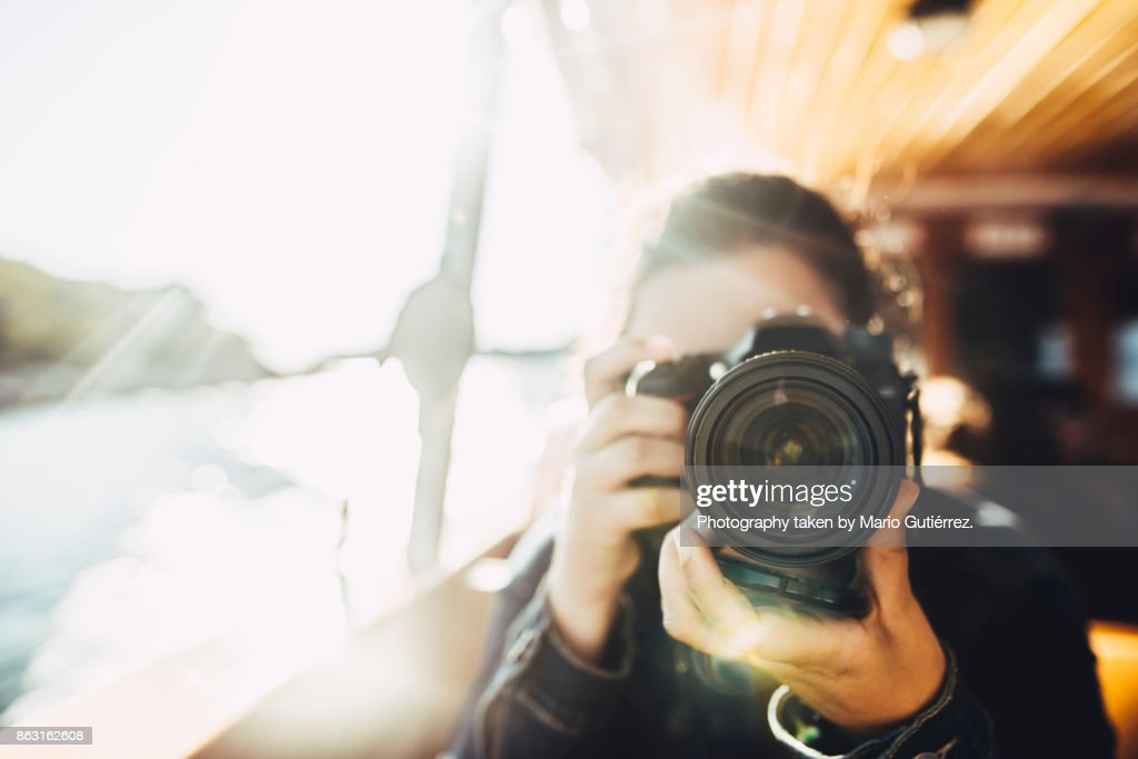 Young woman using a DSLR camera : Stock Photo