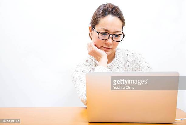 A Young Woman Using a Laptop Computer