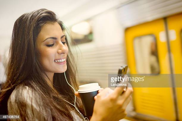 Young woman using a phone at train station in Sydney