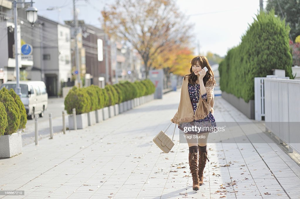 Young woman using a smartphone in the city : Stock Photo