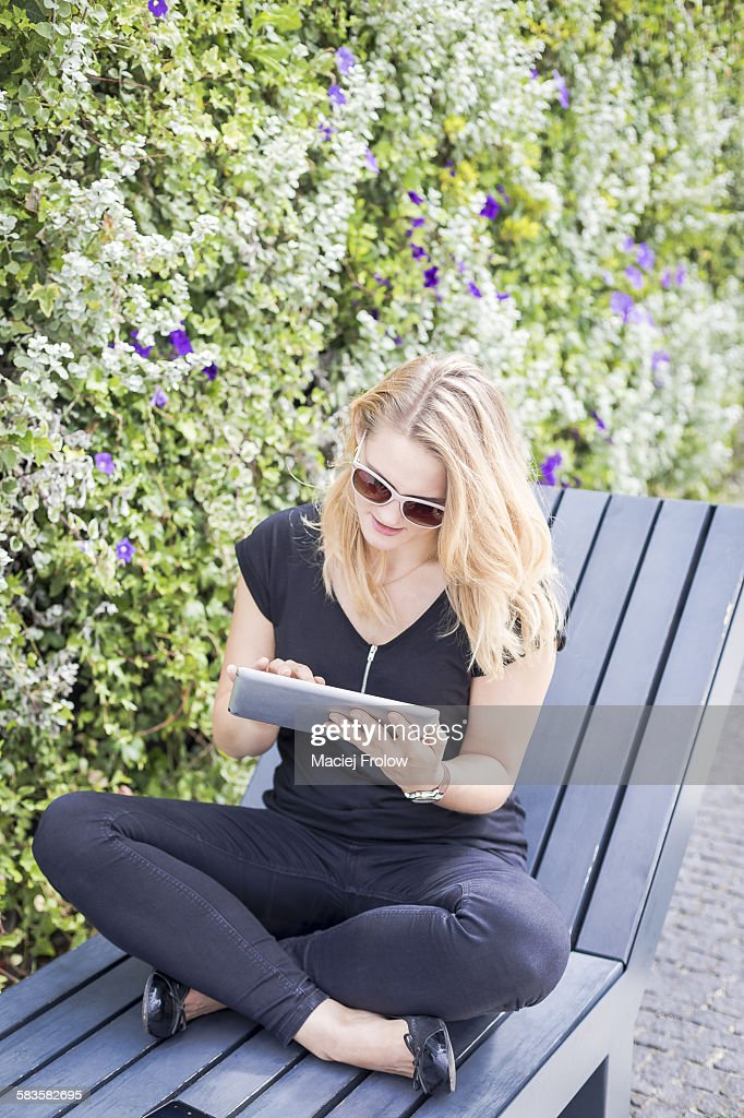 Young woman using a tablet device : Stock Photo