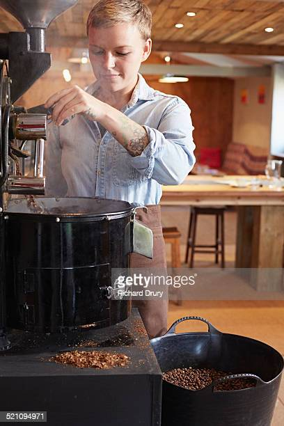 Young woman using coffee roaster