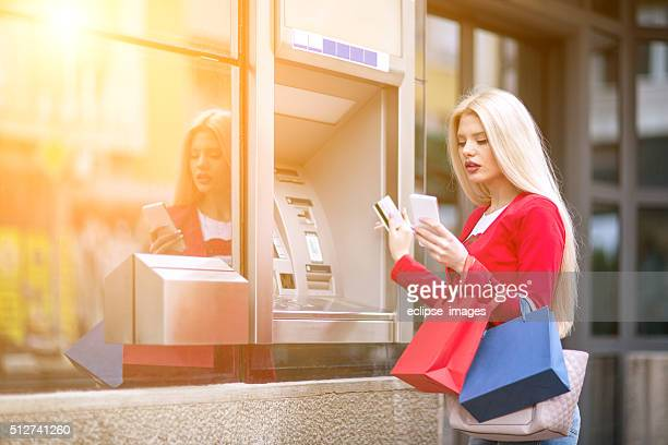 Young woman using credit card