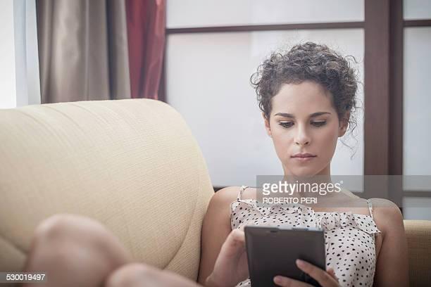 young woman using digital tablet - roberto ricciuti foto e immagini stock