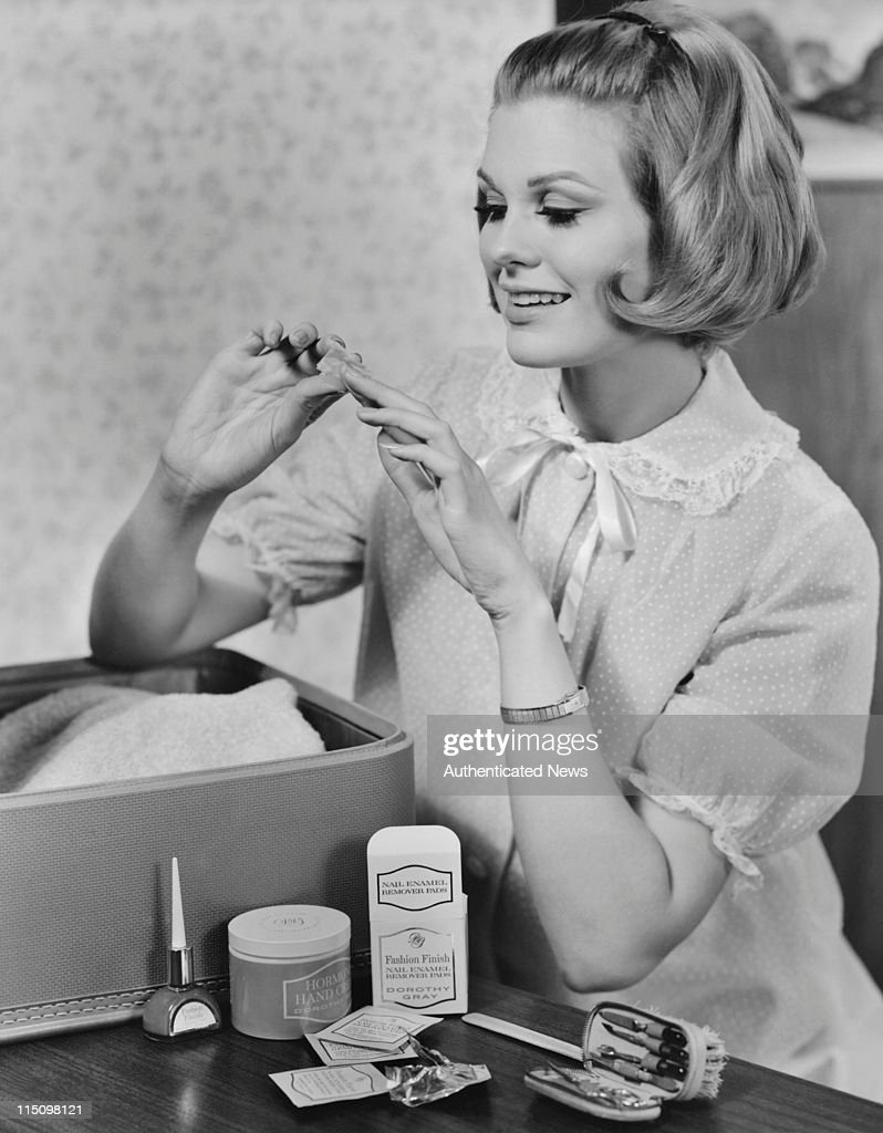A young woman using Dorothy Gray hand and nail products circa 1960.