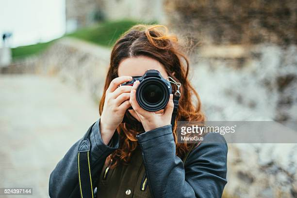 young woman using dslr camera - photographer stock photos and pictures