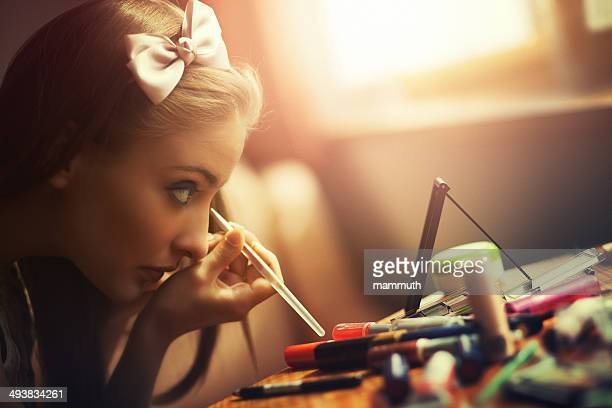 young woman using eyeliner - eye liner stock photos and pictures