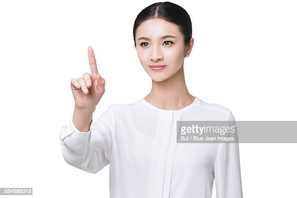 Young woman using finger to point