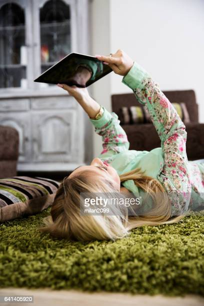 Young woman using her tablet