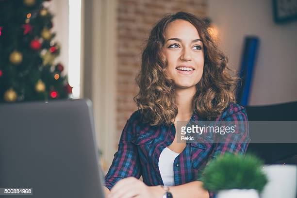 Young woman using laptop at home office