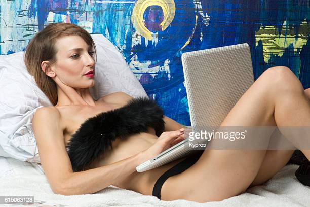 young woman using laptop computer - czech model stock pictures, royalty-free photos & images