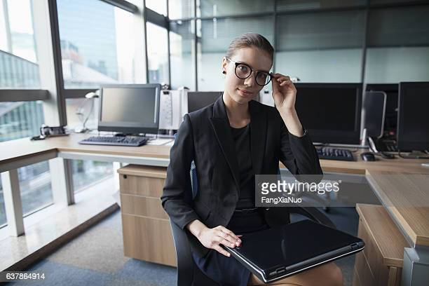 Young woman using laptop in business office