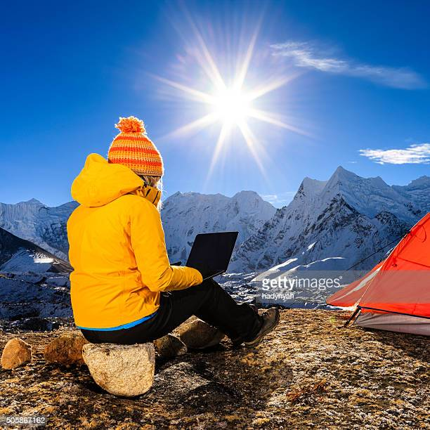 young woman using laptop in himalayas, nepal - solu khumbu stock pictures, royalty-free photos & images