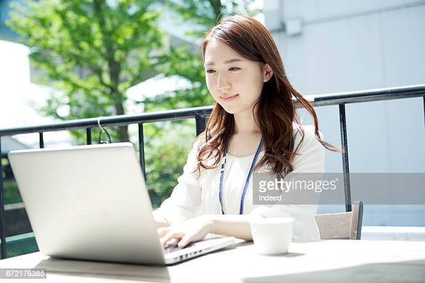 Young woman using laptop in terrace