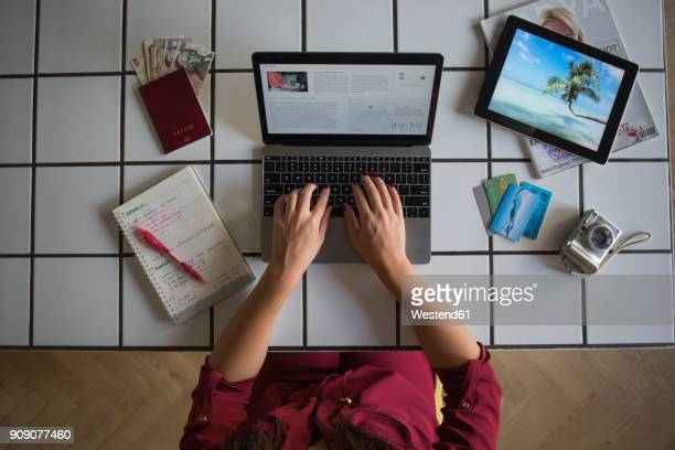 Young woman using laptop, travel booking