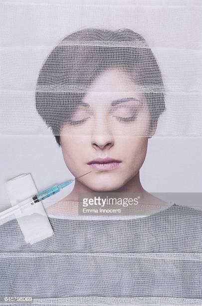 Young woman using lip augmentation