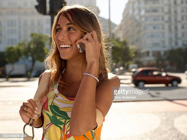 young woman using mobile phone, smiling - copacabana beach stock pictures, royalty-free photos & images