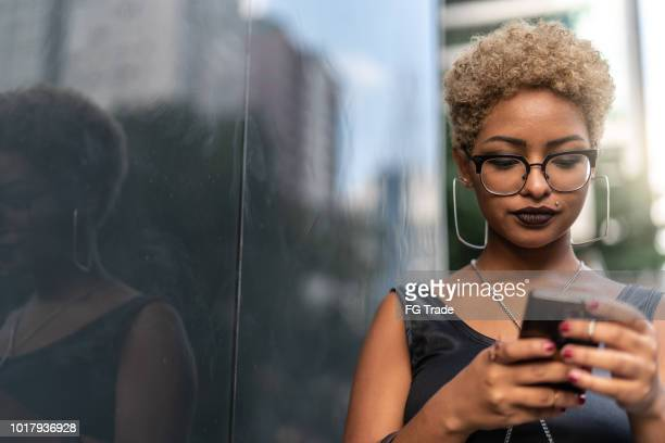 young woman using mobile - brazilian men stock photos and pictures