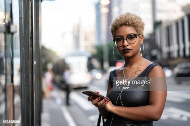 young woman using mobile - alternative lifestyle stock pictures, royalty-free photos & images