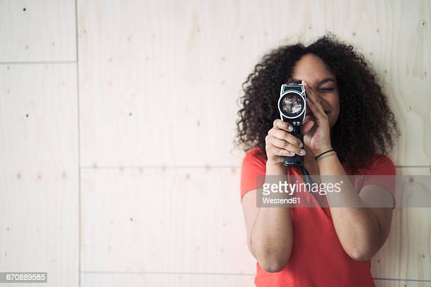 young woman using old school camera - filming stock pictures, royalty-free photos & images