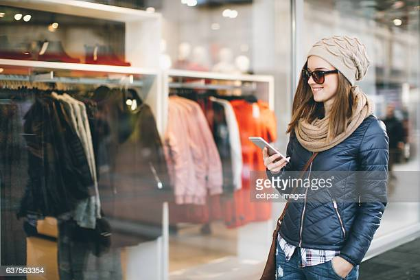Young Woman Using Smart Phone In The Cit