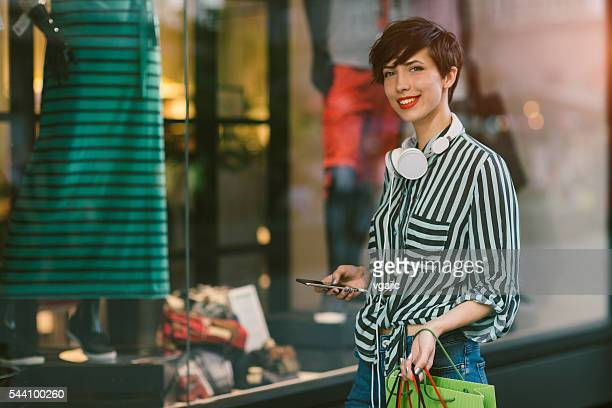 Young Woman Using Smart Phone In The City