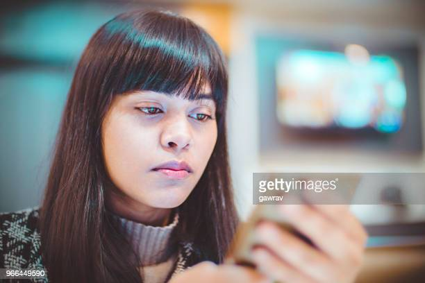 young woman using smart phone without bending neck. - candid forum stock pictures, royalty-free photos & images