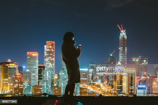 Young woman using Smartphone in urban city