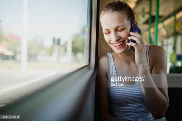 Young Woman Using Smartphone on the Tram