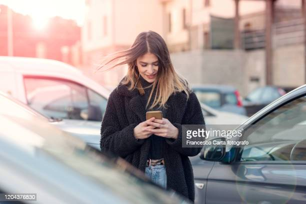 young woman using smartphone - one young woman only stock pictures, royalty-free photos & images
