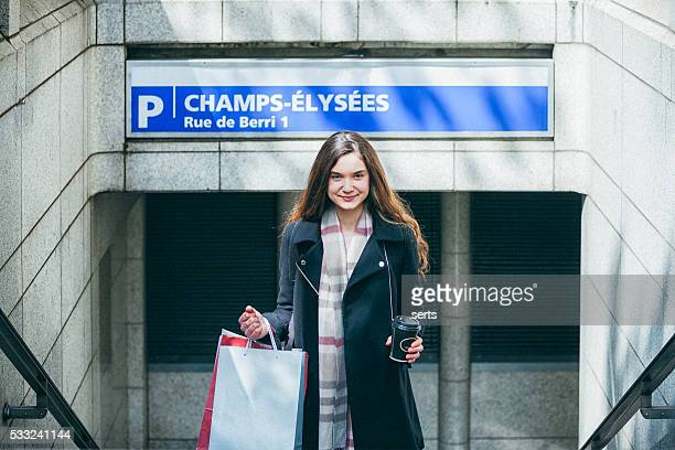 Young woman using subway in Paris